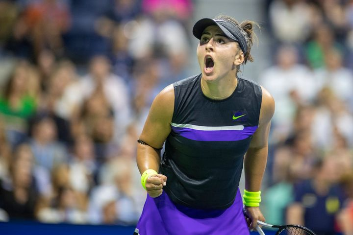 Bianca Andreescu of Canada reacts to winning the second set against Elise Mertens of Belgium in the Women's singles quarter-finals match.
