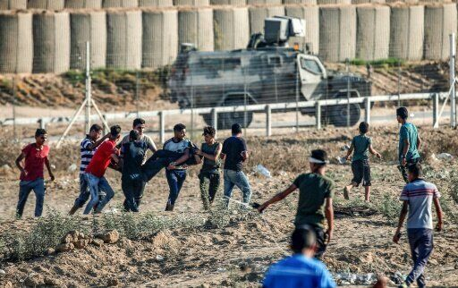 Two Palestinian teenagers and 46 other protesters were wounded during weekly demonstrations along the...