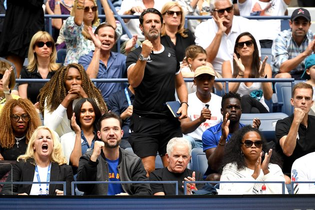 Venus Williams, coach Patrick Mouratoglou, husband Alexis Ohanian, and Meghan, Duchess of Sussex, cheer...