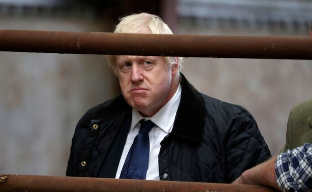 Britain's Prime Minister Boris Johnson visits Darnford Farm in Banchory near Aberdeen, Scotland, Friday...