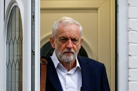 Britain's opposition Labour Party leader Jeremy Corbyn leaves his home in