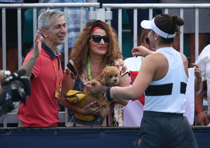 Bianca Andreescu celebrates with her parents after her three set win over Irina-Camelia Begu of Romania during day four of the Miami Open on March 21, 2019.