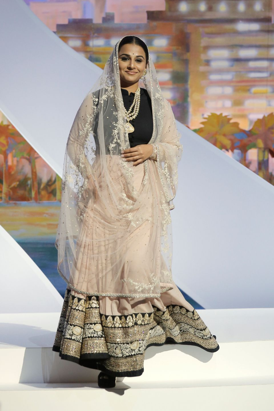 Actress and jury member Vidya Balan acknowledges applause during the opening ceremony ahead of the screening...