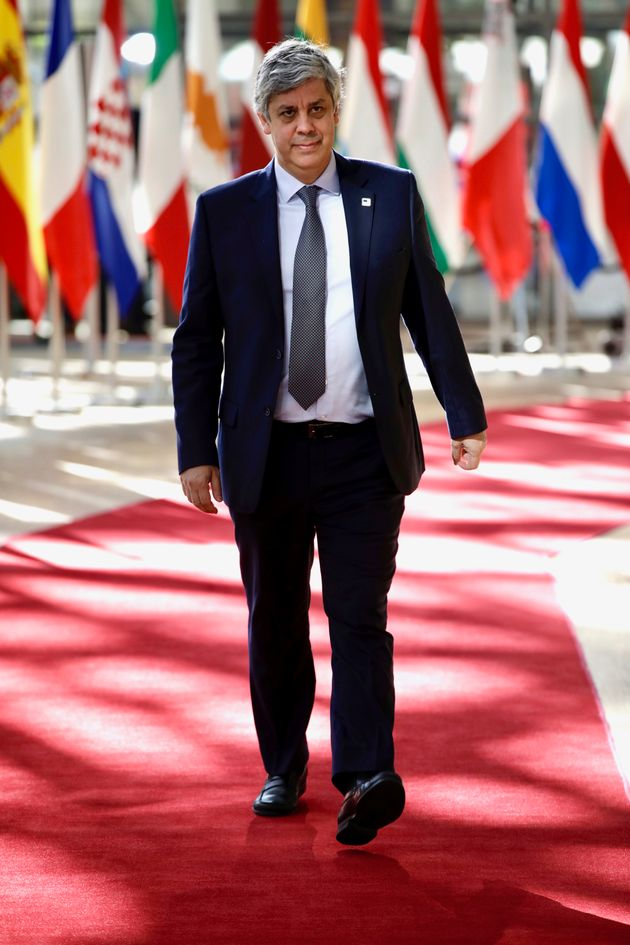 Portuguese Economy Minister Mario Centeno arrives for an EU summit at the Europa building in Brussels,...