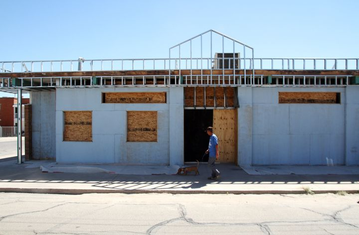 A man walks past the former site of a clinic that offered abortions in El Paso, Texas, on Oct. 3, 2014. Abortion services for