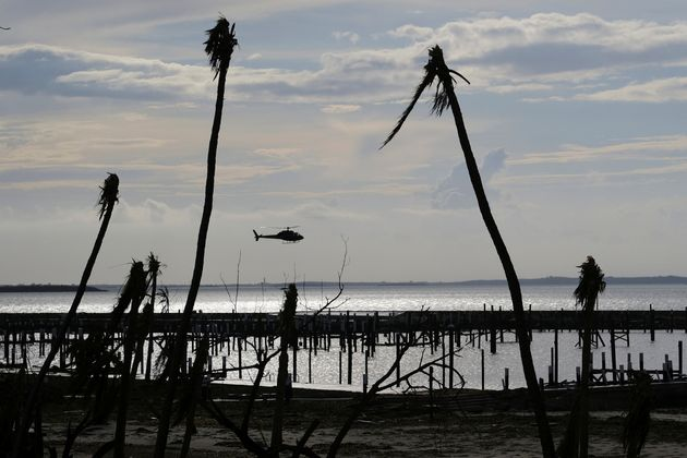 An unidentified helicopter lands to deliver food and water in the aftermath of Hurricane Dorian on the...