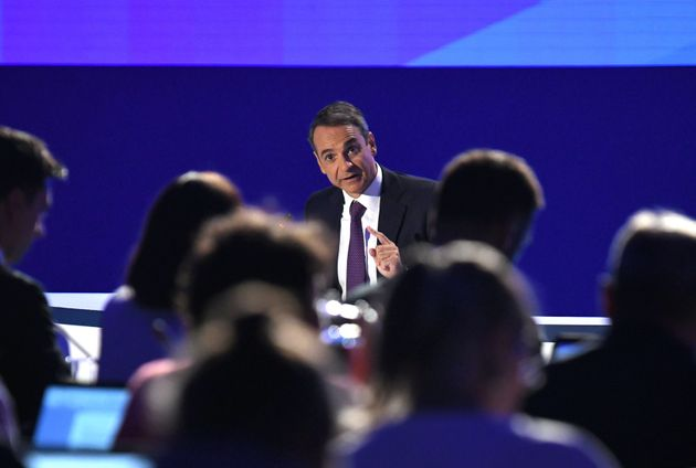 Greek Prime Minister Kyriakos Mitsotakis speaks during a news conference at the annual International...