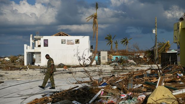 A member of the Bahamian military assesses damage in a destroyed neighborhood in the wake of Hurricane Dorian in Marsh Harbour, Great Abaco, Bahamas, September 7, 2019.  REUTERS/Loren Elliott