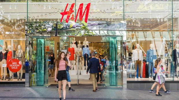 Brisbane, Australia - September 26, 2016: View of a young woman walking out of H&M store in Brisbane. H M is a well-known international fashion retail corporation.