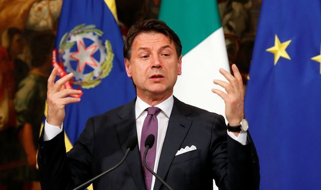 Italian Prime Minister Giuseppe Conte gestures as he attends a news conference at Chigi Palace in Rome,...