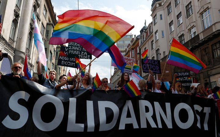 Participants march during the country's first ever LGBT pride parade in downtown Sarajevo, Bosnia-Herzegovina, Sunday, Sept.