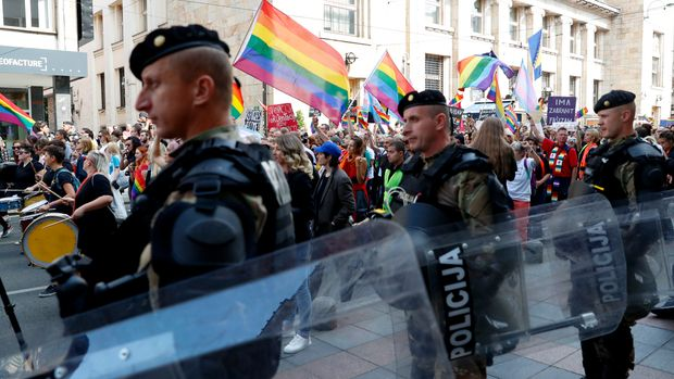 Policemen guard the country's first ever LGBT pride parade in downtown Sarajevo, Bosnia-Herzegovina, Sunday, Sept. 8, 2019. Sarajevo is the last capital city in the Balkans to hold a pride parade after neighboring countries moved to improve LGBT rights. (AP Photo/Darko Bandic)