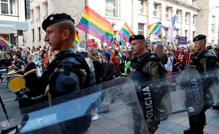 Policemen guard the country's first ever LGBT pride parade in downtown Sarajevo, Bosnia-Herzegovina, Sunday, Sept. 8, 2019. S