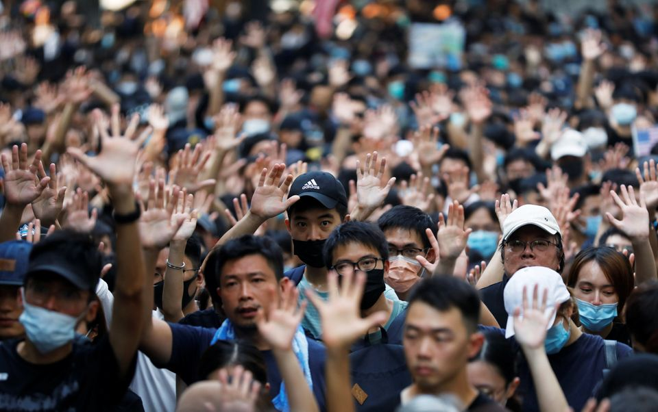 Protesters hold up their five fingers during a rally to the U.S. Consulate General in Hong Kong, China,...