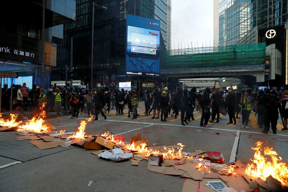 Protestors leave after lighting fire on a road during a rally in Hong Kong, China September 8, 2019....