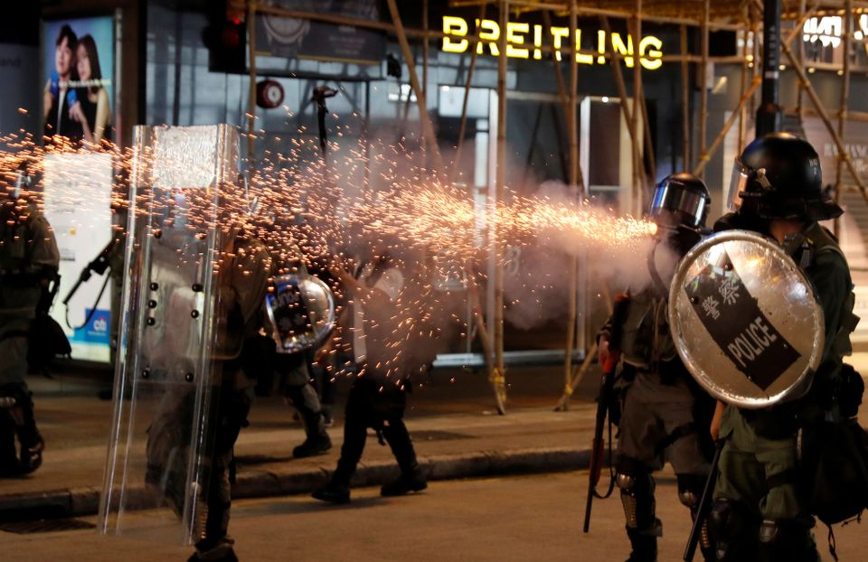 Riot police fire tear gas near Causeway Bay station in Hong Kong, China September 8, 2019. REUTERS/Amr...