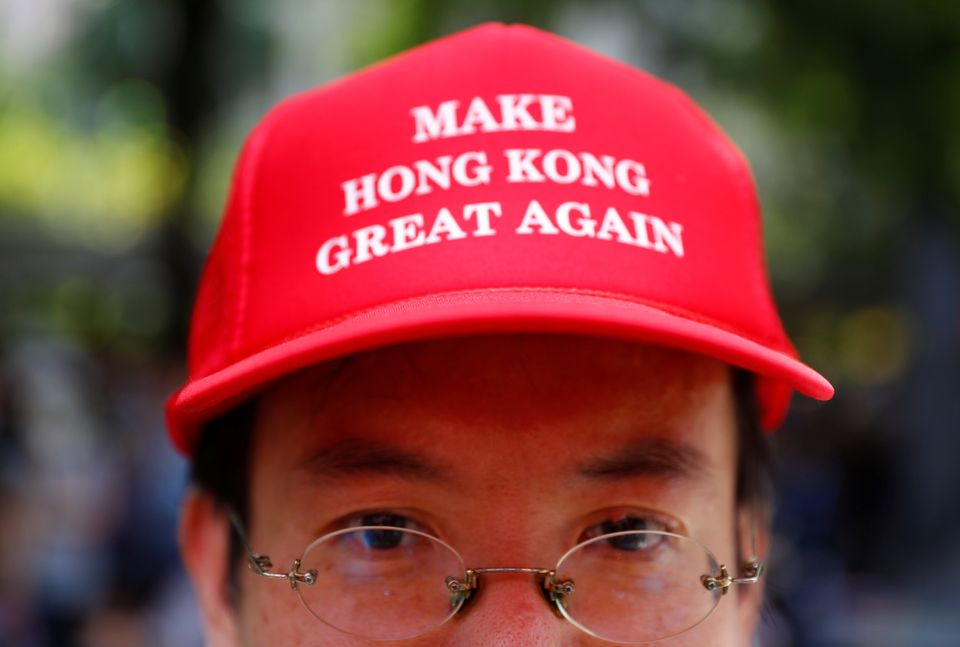 A protester is seen wearing a cap that reads,