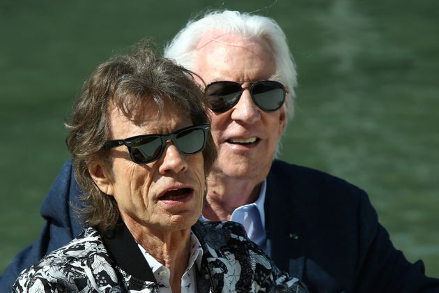 Actors Mick Jagger, left, and Donald Sutherland pose for photographers upon arrival for the photo call...
