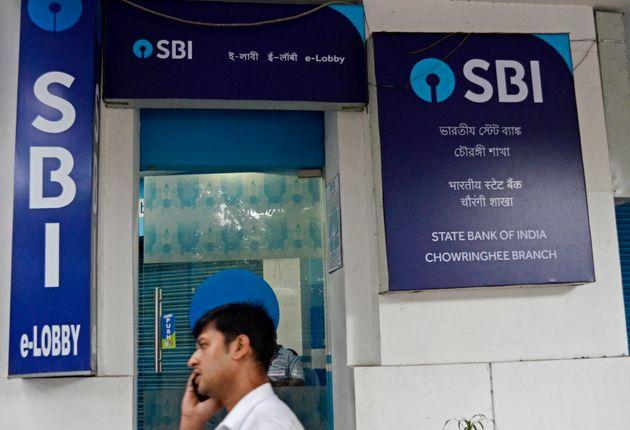 A man walks past SBI ATM in Kolkata on 7 August,