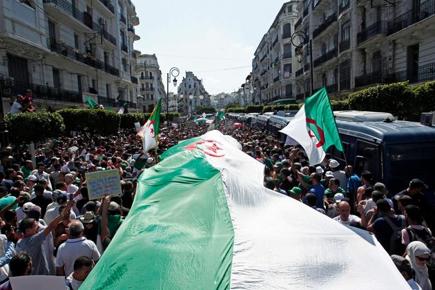 Algerian demonstrators take to the streets in the capital to protest against the government, in Algeria,...