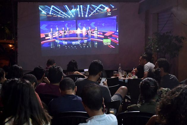Tunisian poeple watch the Presidential TV debate in a cafe on September 7, 2019, in Tunis. - Days before...
