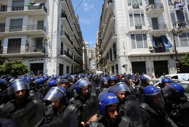Police members stand guard during in an anti-government protest in Algiers, Algeria May 21, 2019. REUTERS/Ramzi