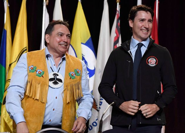 Prime Minister Justin Trudeau looks on after receiving an Assembly of First Nations jacket as a gift...