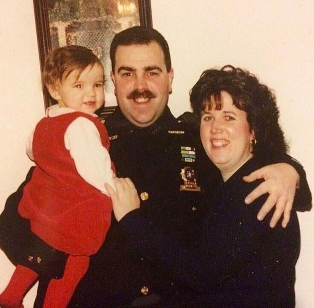 Emily Thomas with her dad and mom. This photo was taken after her father became a NYPD detective in