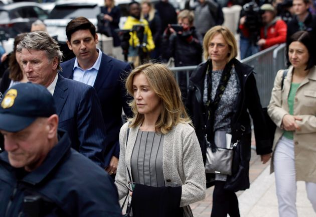 Felicity Huffman departs federal court in Boston, where she pleaded guilty to charges in a nationwide...