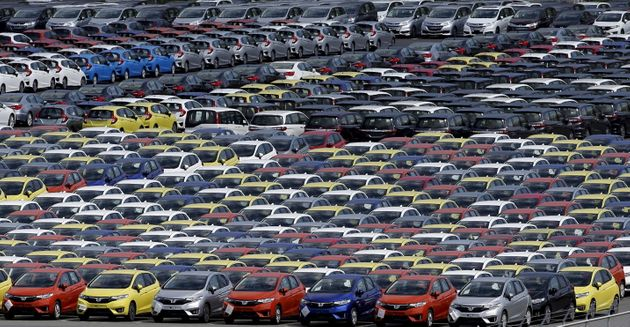 Newly manufactured cars of the automobile maker Honda await export at port in Yokohama, south of Tokyo...