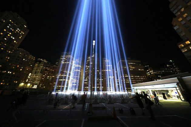 The Tribute in Light beams up into the New York City skyline from the rooftop of a garage in lower Manhattan...
