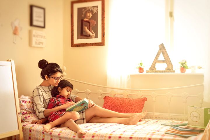 """""""A self portrait of me reading a story to my daughter on a summer afternoon."""""""