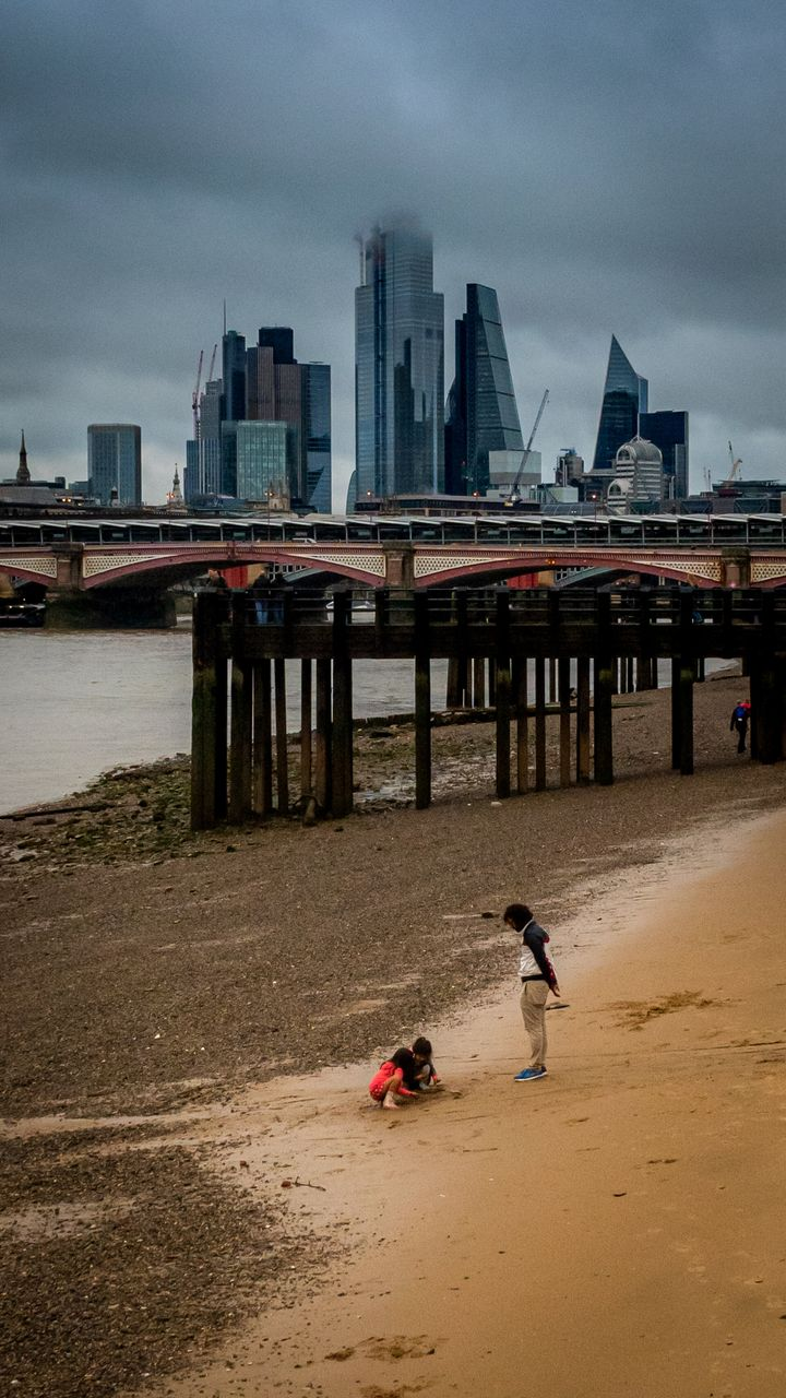"""""""I love the optimism of Londoners on the beach in the rain."""""""