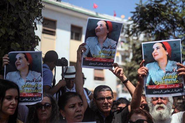 People stage a demonstration outside a court in solidarity with detained journalist Hajar Raissouni,...