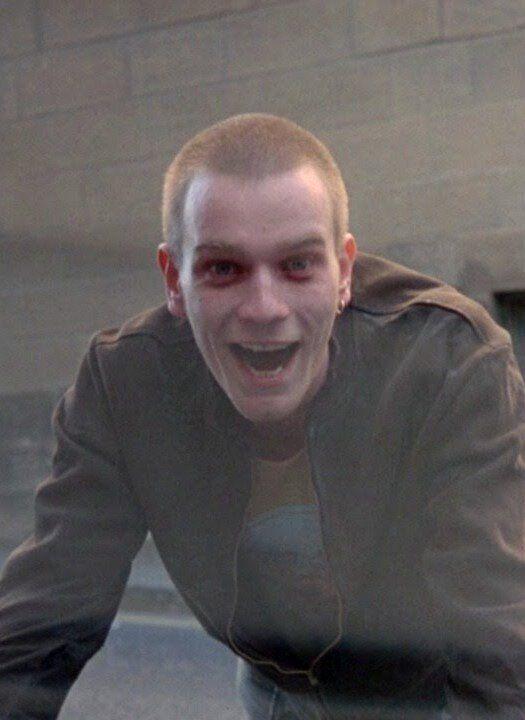Ewan McGregor como Renton na famosa sequência de abertura de