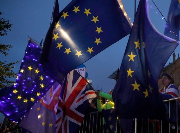 Flags of the U.K. and the EU fly outside the Parliament in London on Monday. British Prime Minister Boris...