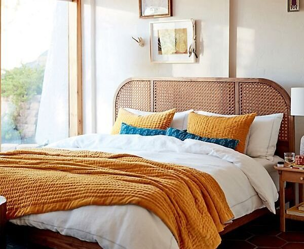 Ochre-colored bedding is a great way to bring this trend to your