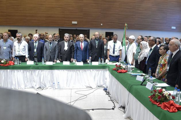 This picture taken on July 6, 2019 shows former Algerian prime minister Ali Benflis (2nd-R) and the president...