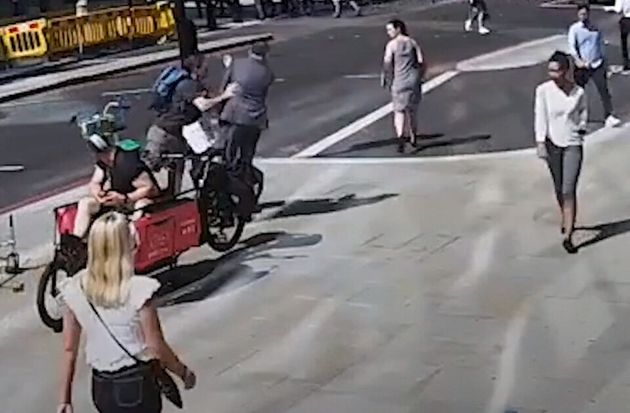 Police Hunting Cyclist Who Ran Red Light, Then Headbutted Pedestrian To The Ground