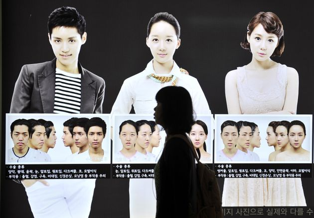 A street billboard advertises plastic surgery at a subway station in Seoul. South Korea's obsession with...