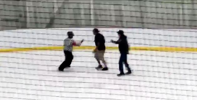 Two people can be seen chasing a referee at a three-on-three youth hockey tournament in Lethbridge, Alta.,...
