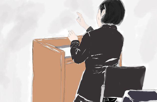 証人尋問でDVの構造について手ぶりを交え説明する精神科医