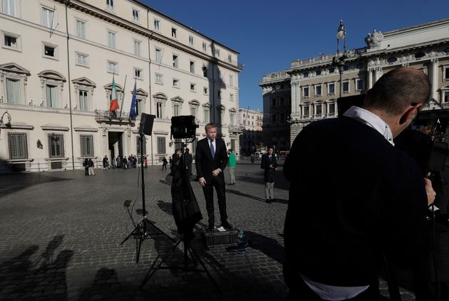 Journalists outside Palazzo Chigi premier's office cover the outcome of a referendum on constitutional...