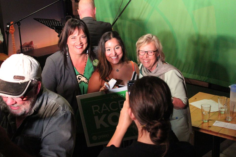 Green Party leader Elizabeth May and Victoria candidate Racelle Kooy pose with supporters following a...