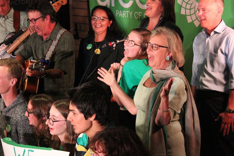 Green Party leader Elizabeth May and supporters sing during a rally in Victoria Sept.