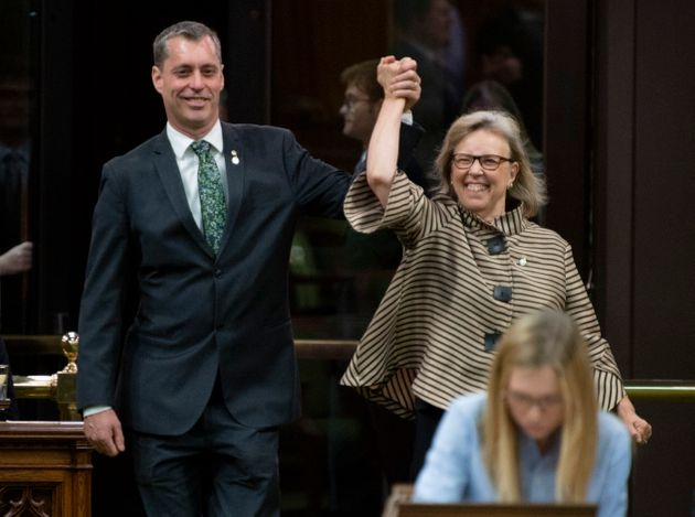 Green Party Leader Elizabeth May enters the House of Commons with the newly sworn in MP Paul Manly before...