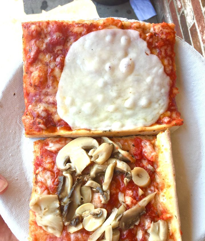 Provolone-draped slices of beach pizza from Cristy's in New Hampshire.