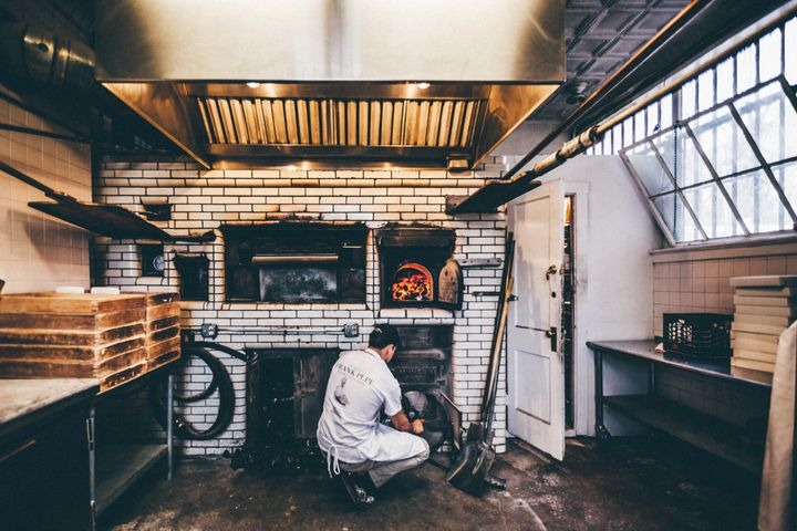 The pizza makers at Pepe's in New Haven use a coal-fired oven.
