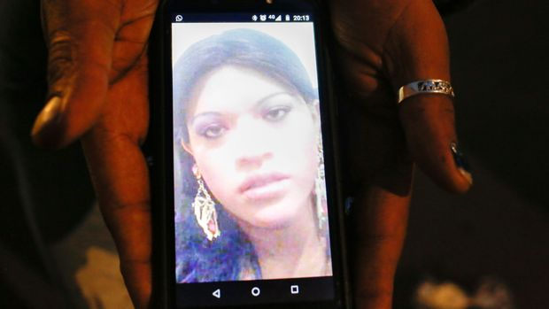 In this Aug. 28, 2019 photo, trans rights activist Kenya Cuevas holds a cellphone that shows an image of her slain friend Paola Buenrostro, in Mexico City. On Sept. 29, 2016 Buenrostro got into a client's Nissan compact car and was shot multiple times. Despite multiple witnesses, Buenrostro's alleged killer was released from custody a few days later.(AP Photo/Ginnette Riquelme)