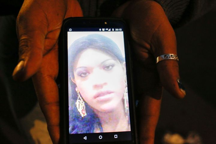 Trans rights activist Kenya Cuevas holds a cellphone that shows an image of her slain friend Paola Buenrostro, in Mexico City